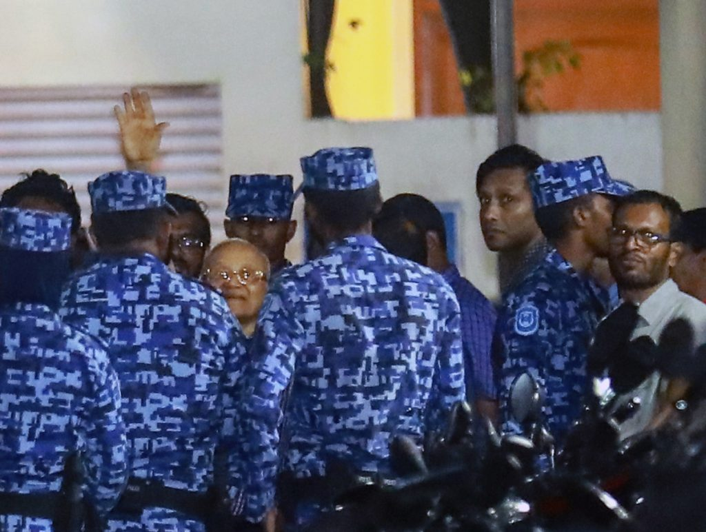 Police officers arrest former president and opposition leader Maumoon Abdul Gayoom, center, Tuesday after the government declared a state of emergency in Male, Maldives.