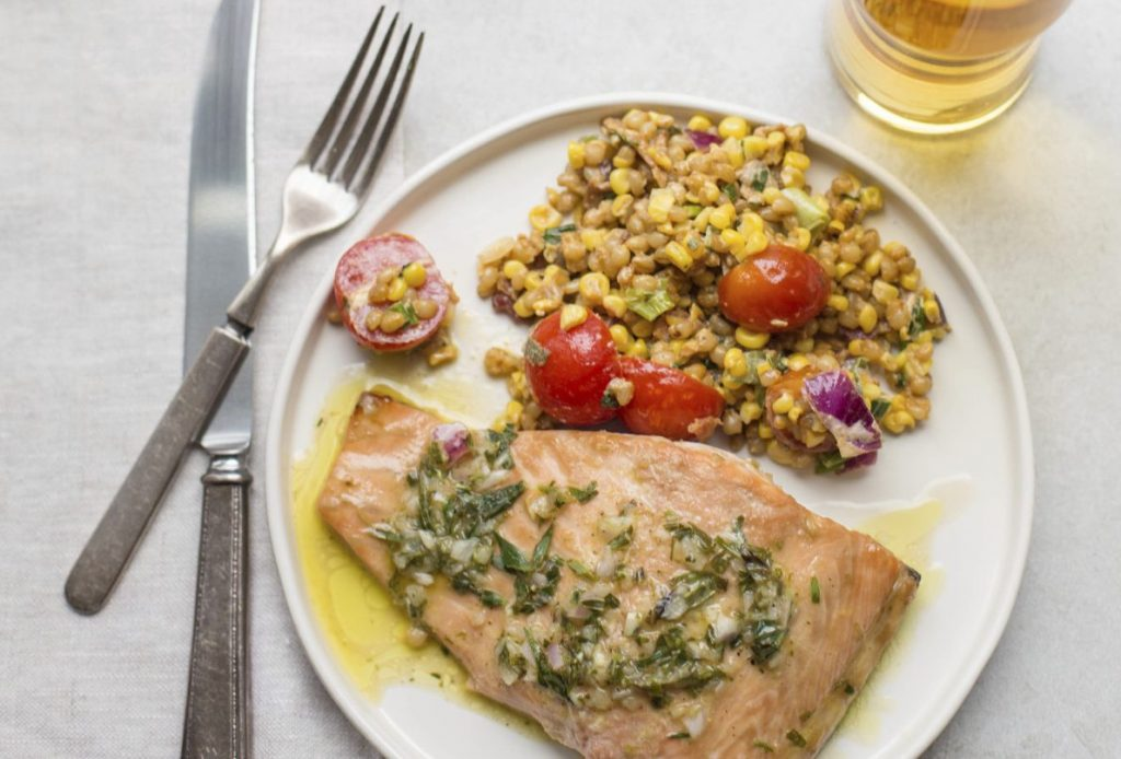 Salmon with a tarragon vinaigrette. Try starting the fish in a pan and later transferring it to the stove.