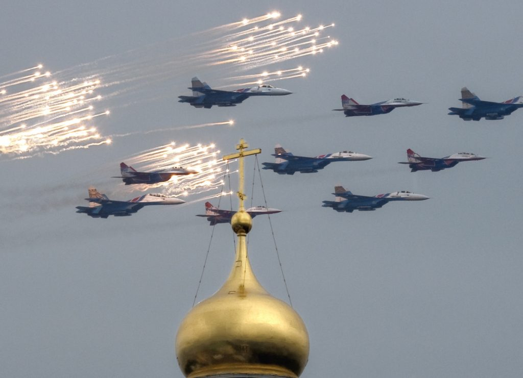 Fighter jets release anti-missile flares as they fly over the Ivan the Great Bell Tower of the Kremlin in 2009.