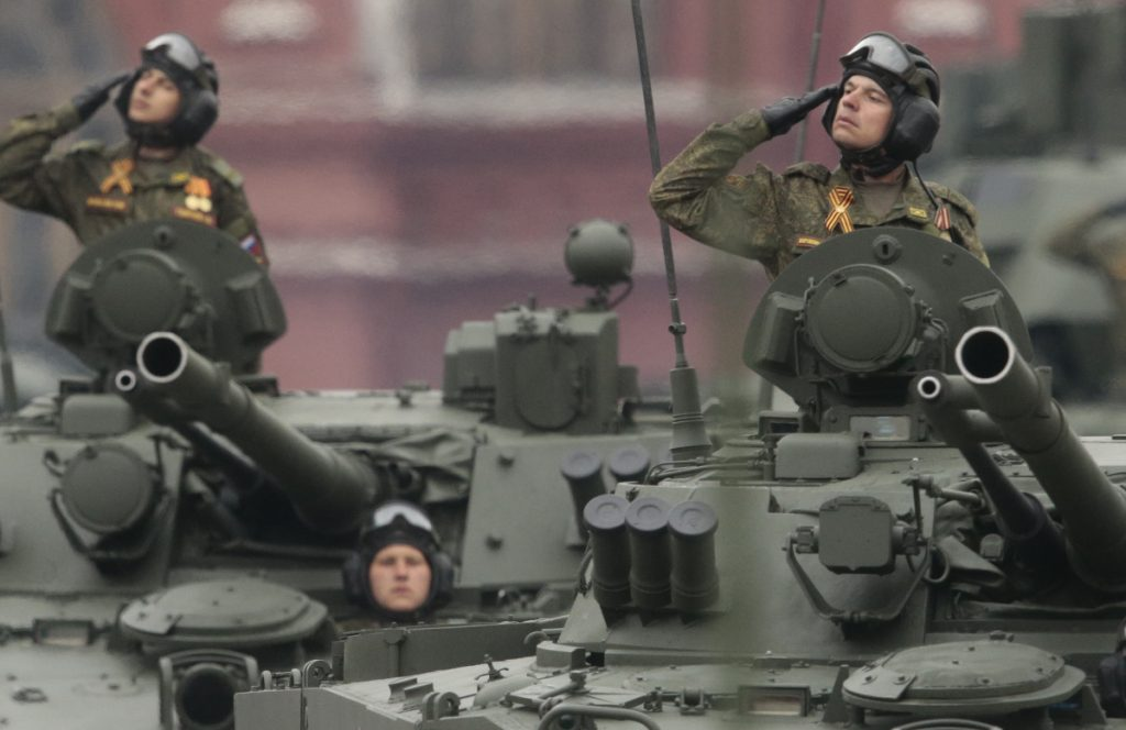 Russian soldiers in tanks drive past a reviewing stand during a parade in Moscow's Red Square last year.