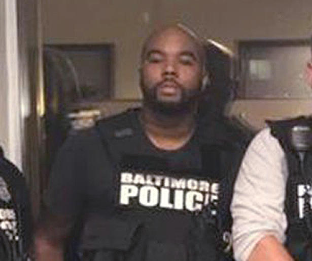 Detectives Marcus Taylor, left, and Daniel Hersl are on trial in Baltimore.