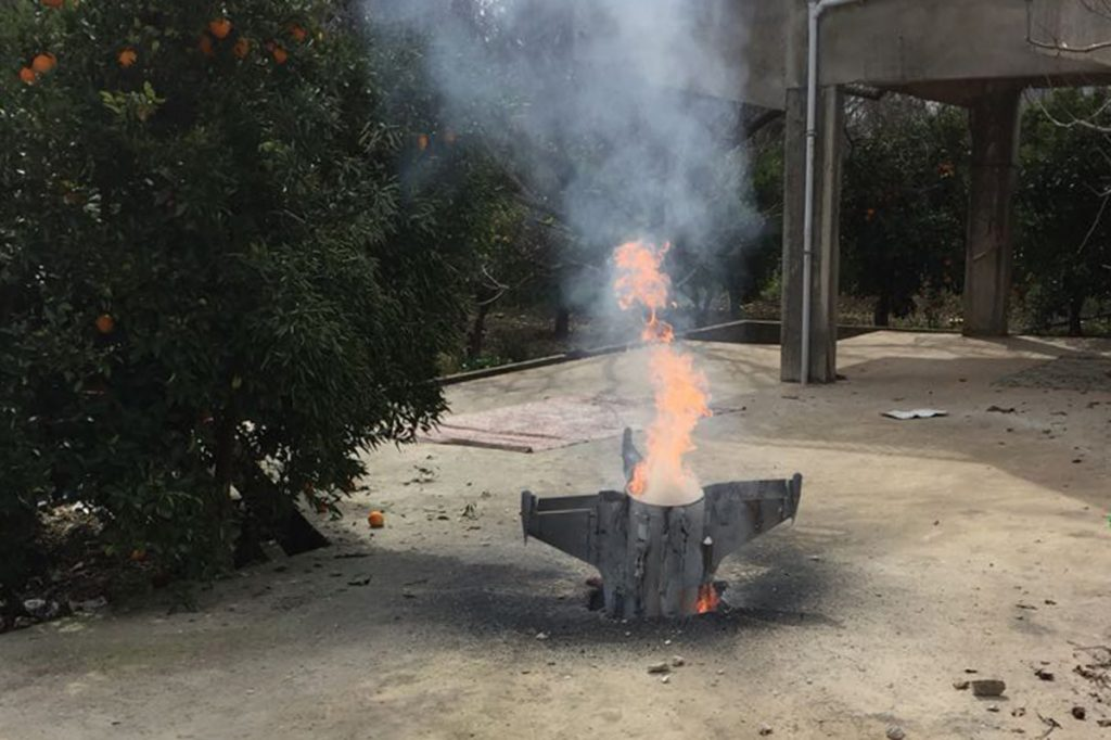 Flames rise from what the Lebanon national news agency said was a Syrian missile targeting an Israeli warplane which landed in a lemon grove in southwest Lebanon on Saturday.