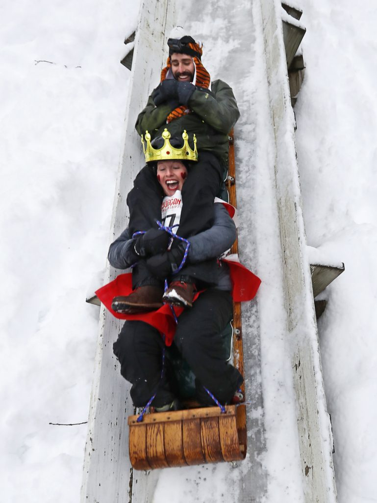 Shannon Bryan shrieks on a toboggan run with teammate Josh Smigelski at the National Toboggan Championships on Saturday in Camden. More than 350 teams are competing. Associated Press/Robert F. Bukaty