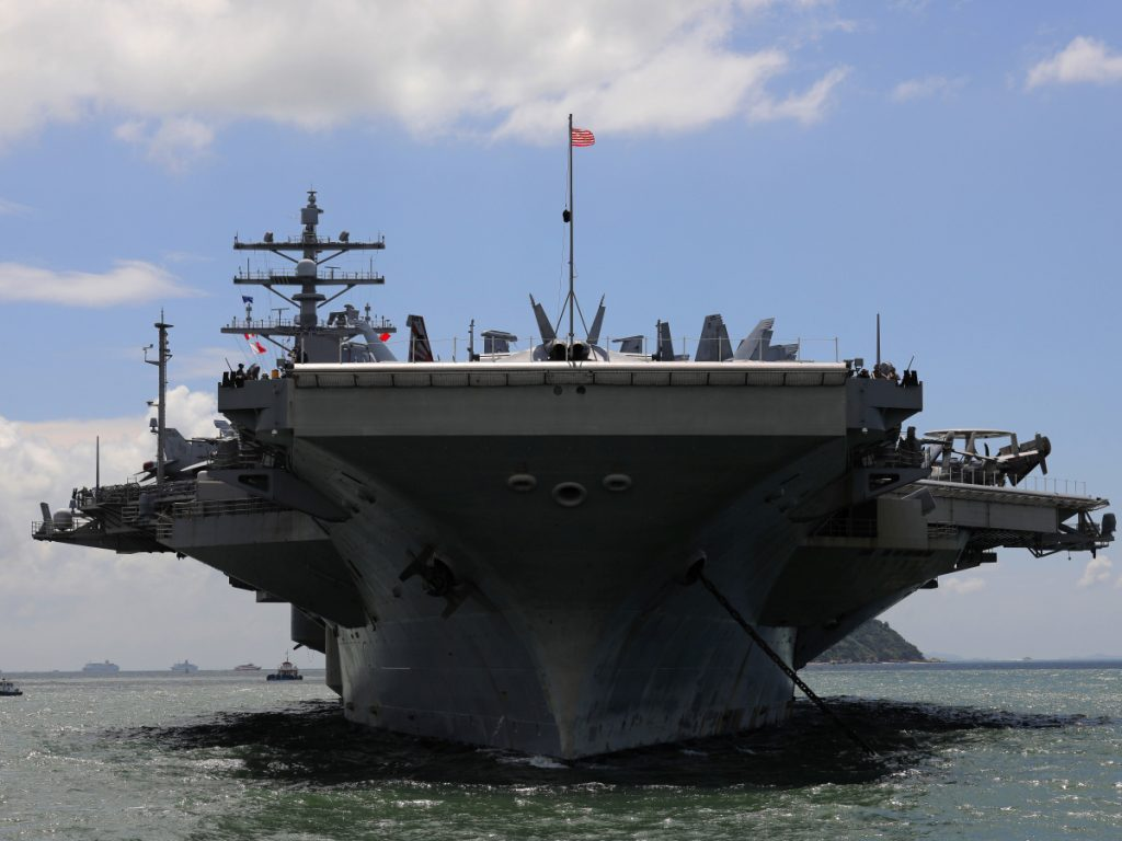 The USS Ronald Reagan aircraft carrier arrives in Hong Kong last October. The $700 billion Pentagon budget that President Trump signed Friday means the military can foot the bill for thousands more troops, more training, more ships and a lot else.