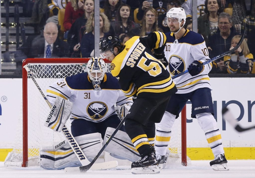 Ryan Spooner of the Bruins looks for an opening against Sabres goalie Chad Johnson during Buffalo's 4-2 win Saturday night in Boston.