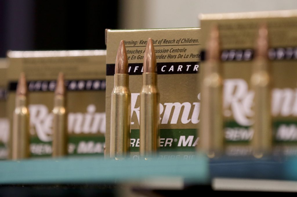 Remington rifle cartridges are displayed at the 35th annual SHOT Show in Las Vegas. Remington, the gunmaker beset by falling sales and lawsuits tied to the Sandy Hook Elementary School massacre, is filing for bankruptcy.