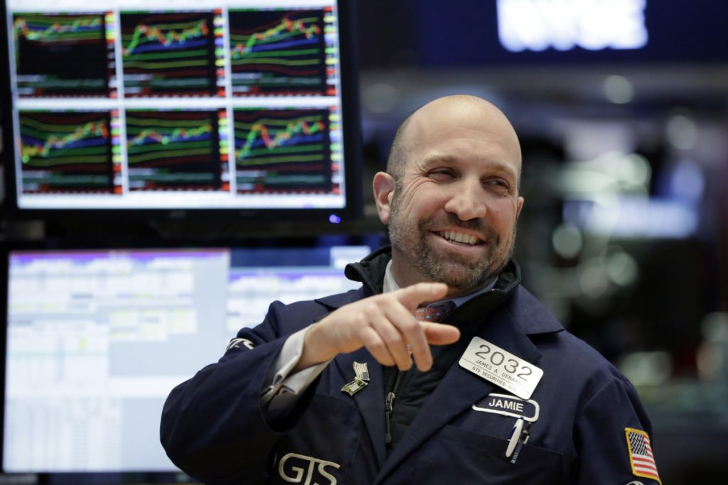 Specialist James Denaro works on the floor of the New York Stock Exchange on Monday.