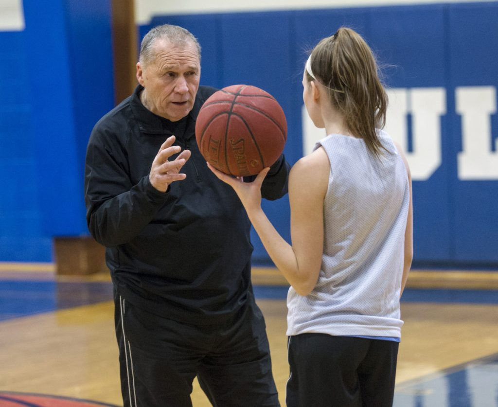 Ron Cote, who coached the Biddeford High boys' and girls' teams, and at the University of New England, works with the Old Orchard Beach girls, including freshman Shani Plante.