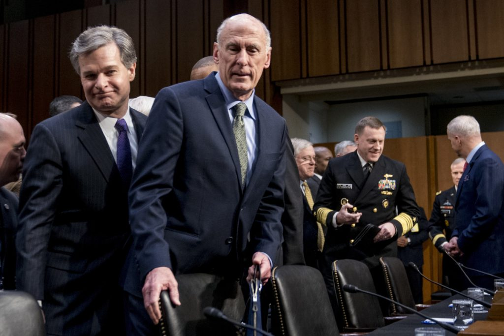 FBI Director Christopher Wray, left, and Director of National Intelligence Dan Coats, second from left, arrive for a Senate Select Committee on Intelligence hearing on worldwide threats on Tuesday in Washington.