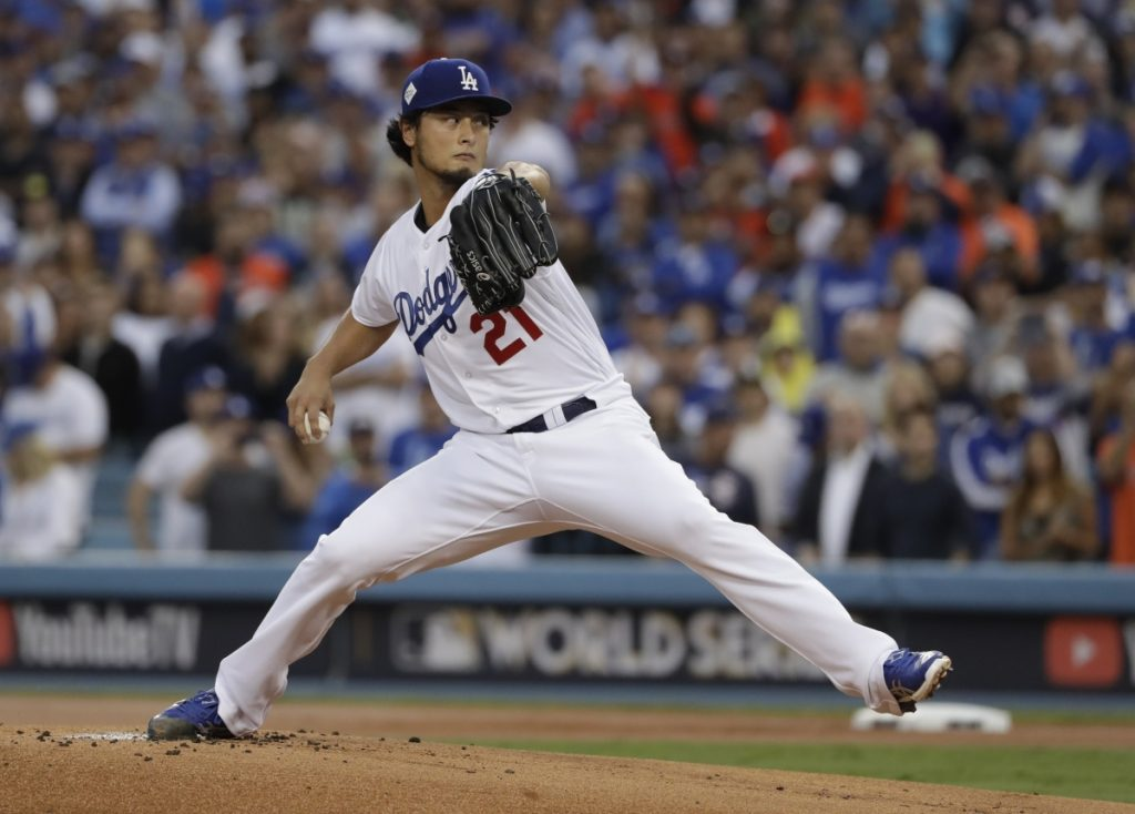 Former Dodgers starting pitcher Yu Darvish throws during the first inning of Game 7 of the World Series against the Astros in Los Angeles.