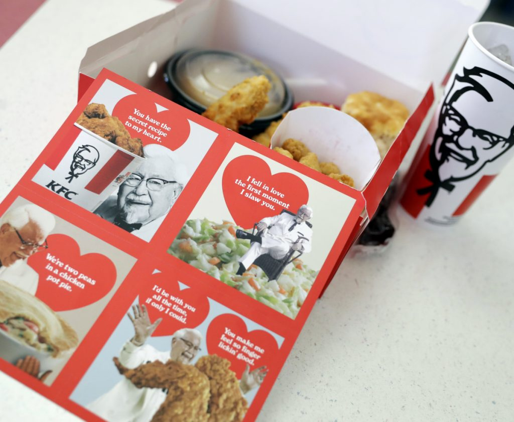 For Valentine's Day, KFC is handing out scratch-and-sniff cards to diners who buy its $10 Chicken Share meals.