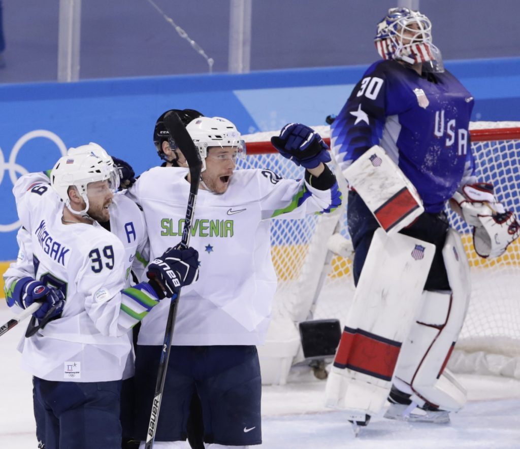 USA goalie Ryan Zapolski can only look at the scoreboard after Jan Mursak scores in OT to give Slovenia a 3-2 win. The U.S. blew a two-goal lead in its first game in South Korea.