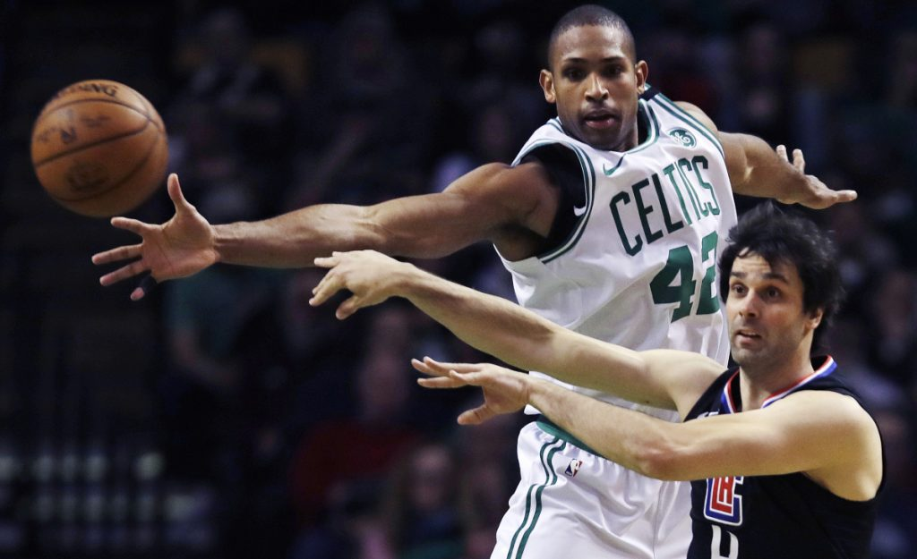 Clippers guard Milos Teodosic, right, passes the ball as he is pressured by Boston's Al Horford in the second quarter Wednesday night in Boston.