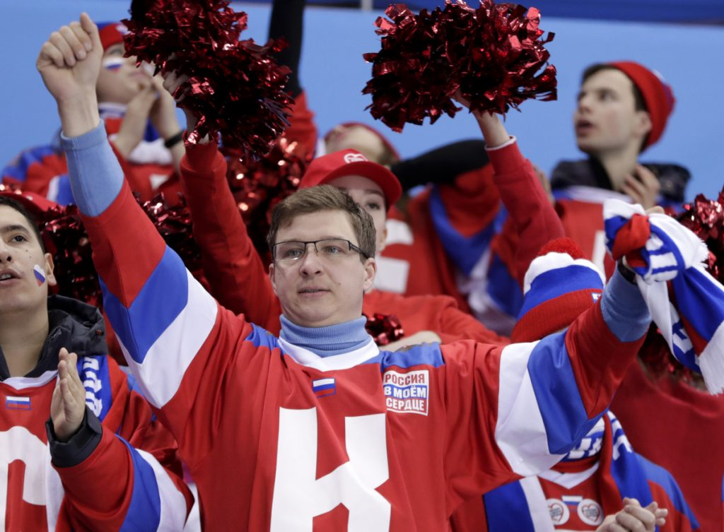 Fans can wear Russia's hockey jerseys, but the players have 'Olympic Athletes from Russia' gear.