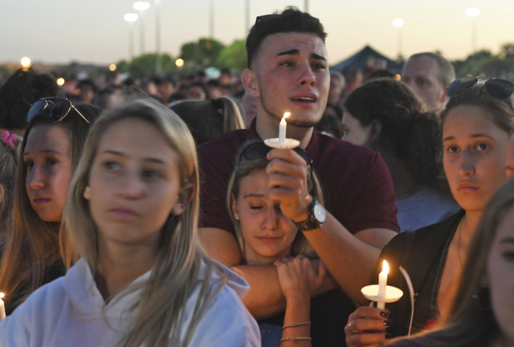 Mourners gather at a vigil that was held for the victims of the shooting at Marjory Stoneman Douglas High School on Thursday.