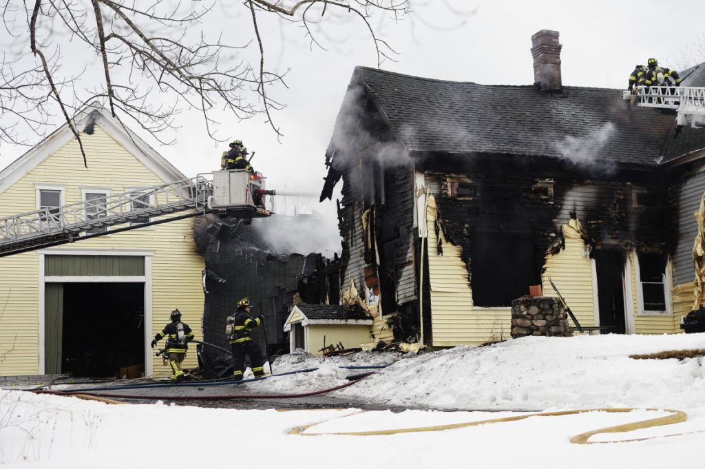 Firefighters battle a two-alarm fire at a home on Chicopee Road in Standish on Friday.