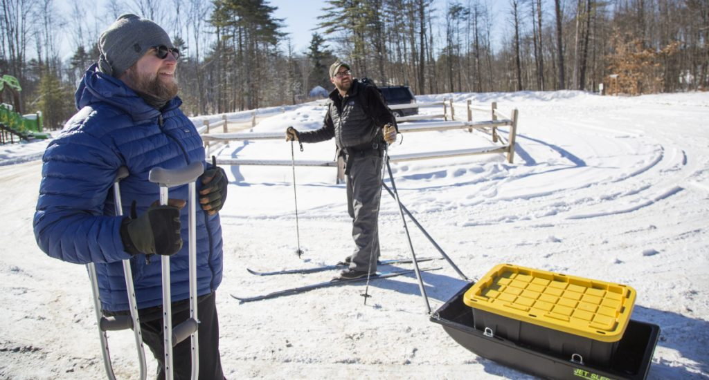 Jeff Anderson, left, and Stephen Bailey, who are avid winter campers, show off one of the homemade camping sleds that they designed for their trips.