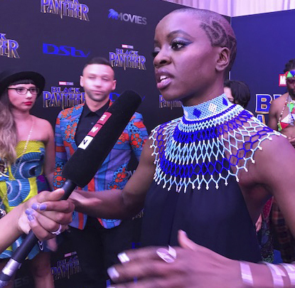 "Above, T'Challa (Chadwick Boseman) is the king of the Afro-futuristic nation of Wakanda in ""Black Panther."" Left, cast member Danai Gurira at the film's South Africa premiere on Friday in Johannesburg."