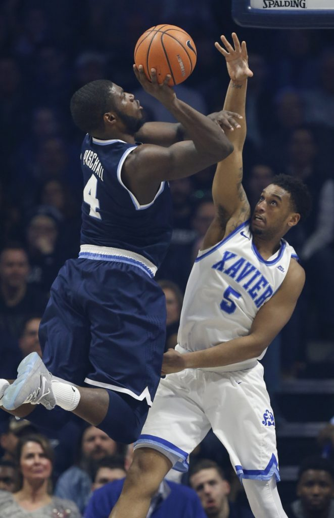Villanova forward Eric Paschall shoots against Xavier guard Trevon Bluiett during the first half of the Wildcats' 95-79 victory at Cincinnati on Saturday.