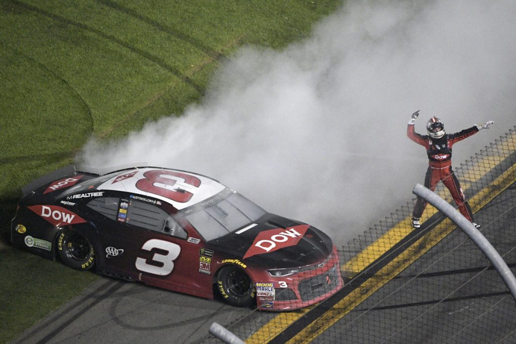 Austin Dillon celebrates on the track after winning the Daytona 500 on Sunday at Daytona International Speedway.