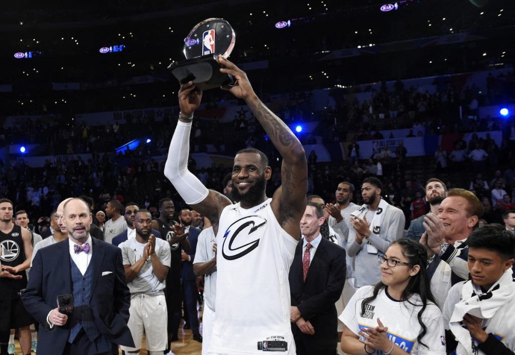 Associated Press/Chris Pizzello Team LeBron's LeBron James, of the Cleveland Cavaliers, holds the MVP trophy after his team defeated Team Stephen at the NBA All-Star basketball game on Sunday in Los Angeles. Team LeBron won 148-145.