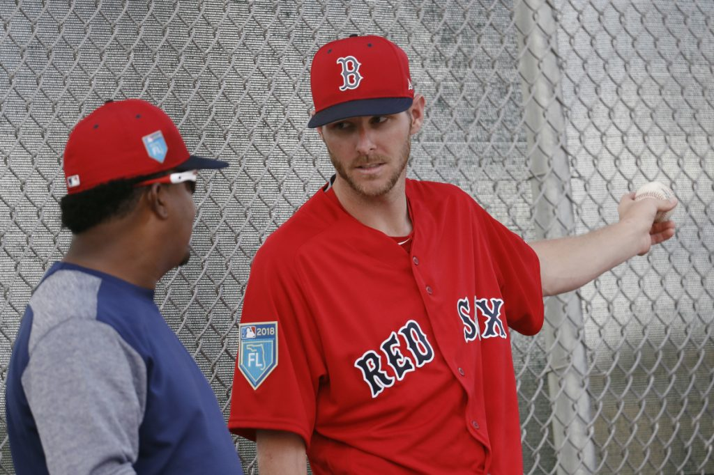 Boston Red Sox starting pitcher Chris Sale, right, speaks with former Red Sox hall of fame pitcher Pedro Martinez during baseball spring training Wednesday in Fort Myers, Fla.