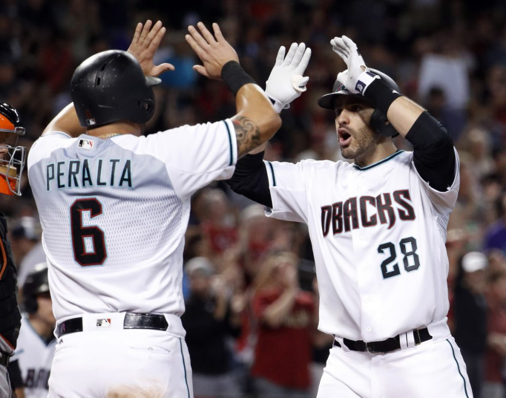 J.D. Martinez, right, who hit 45 home runs and drove in 104 runs last season, has agreed to a five-year, $110-million deal with the Red Sox, according to a source.