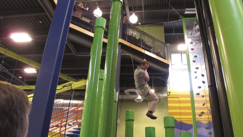 Jason Maulucci of the Vermont governor's office tries a new indoor climbing facility at Jay Peak ski area. Resorts in the region offer other activities, such as water parks, swimming or laser tag, for use when ski conditions are poor.