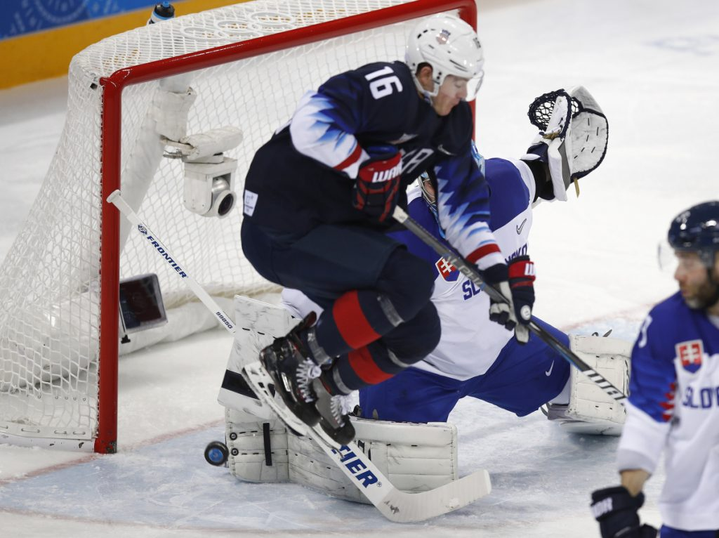 Ryan Donato jumps to let the puck shot by James Wisniewski through for a goal during the second period against Slovakia at the 2018 Winter Olympics in South Korea on Tuesday.