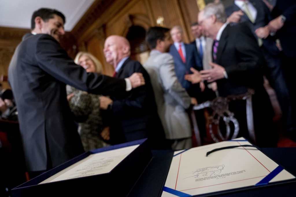 Republicans celebrate Dec. 21 after signing the final version of their tax reform bill in Washington. A survey found stock analysts expect companies to allocate 43 percent of tax savings to dividends and buybacks.