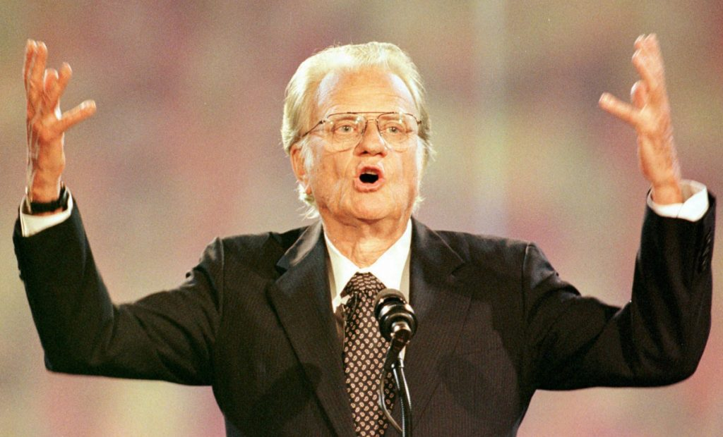 Graham speaks to a crowd in Charlotte, N.C., in 1996. In 1993, he announced that he had Parkinson's disease. He was found dead Wednesday at his home in Montreat, N.C.