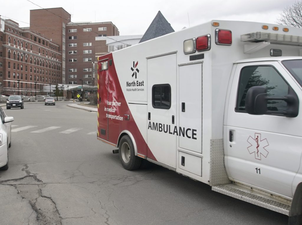 A North East Mobile Health Services ambulance leaves Maine Medical Center in Portland on Friday. North East and the hospital have agreed to settle federal claims of improper billing.