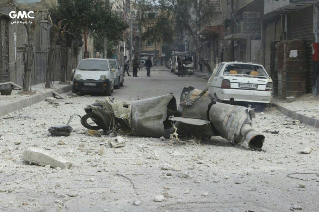 An anti-government activist group in Syria released this photograph Friday showing the remains of a missile lying on a street in Ghouta.