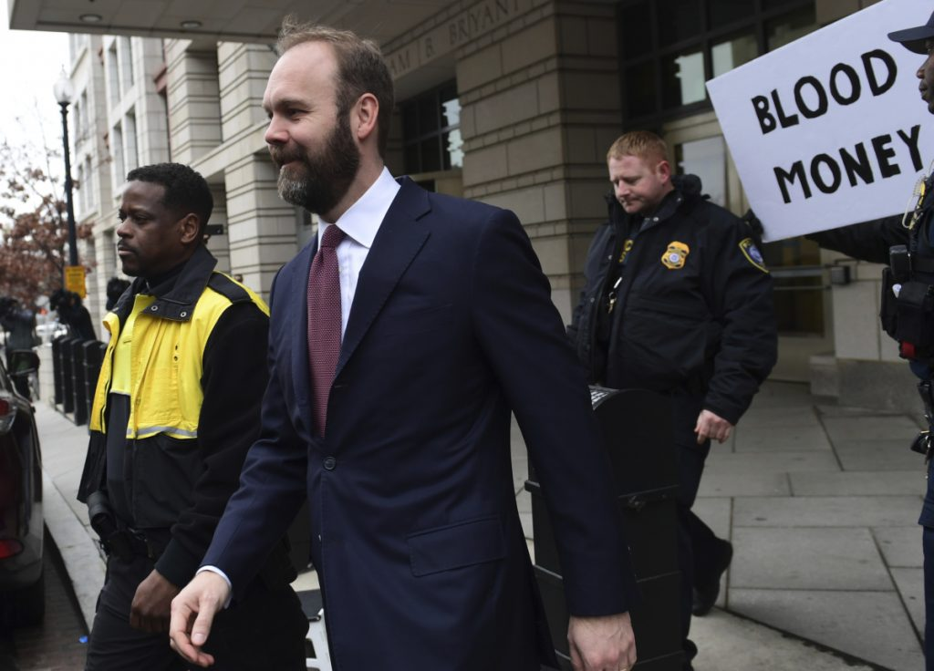 Rick Gates leaves federal court in Washington on Friday. Gates will face an estimated 57 to 71 months in prison.