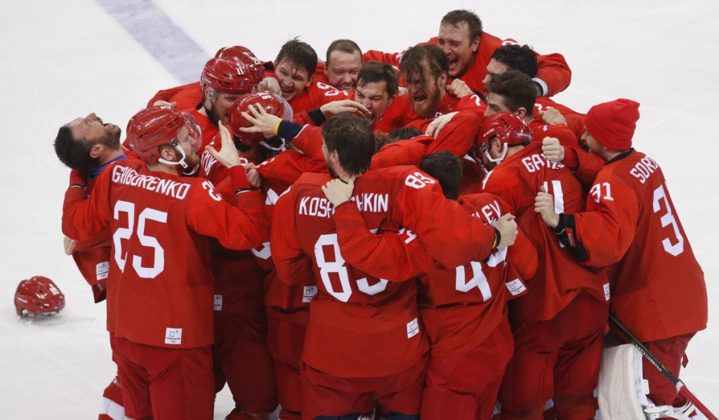 With the gold medal on the line, the Russian hockey team came through Sunday, coming from behind late in regulation, then scoring in overtime to defeat Germany 4-3 in the men's gold-medal game.