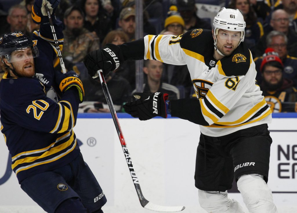 Buffalo forward Scott Wilson is checked by Boston forward Rick Nash during the third period of the Bruins' 4-1 loss on Sunday in Buffalo, New York. Nash was acquired by the Bruins on Sunday morning in a trade with the New York Rangers.