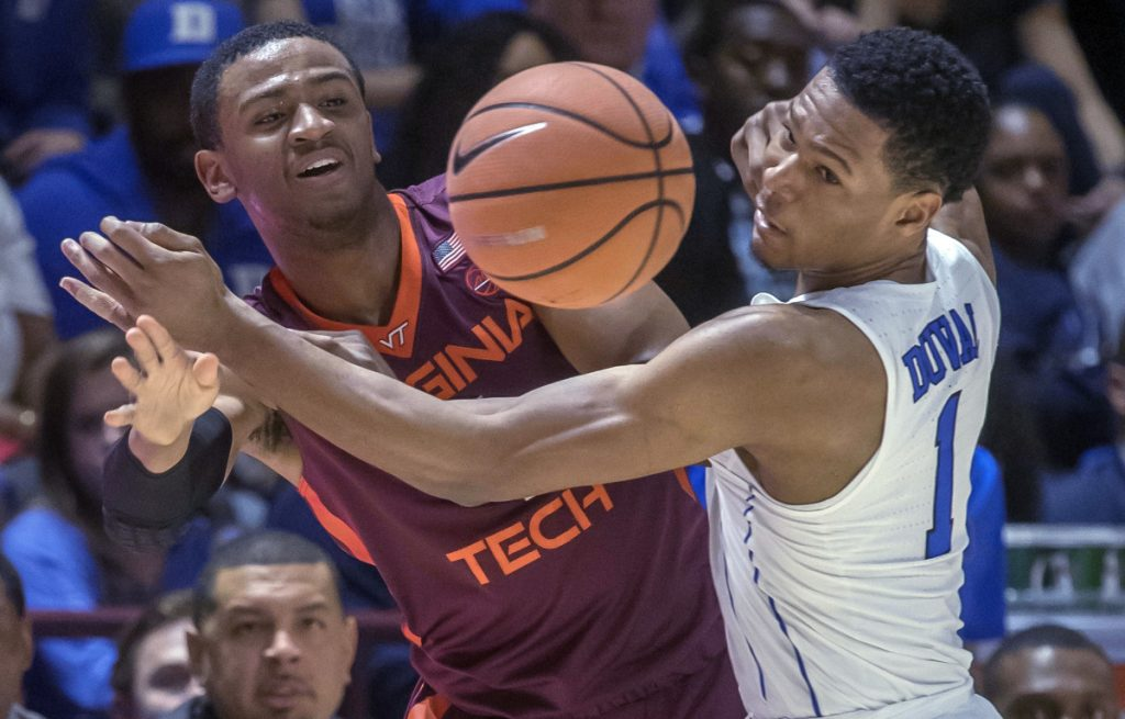 Nickeil Alexander-Walker of Virginia Tech, left, and Trevon Duval of Duke compete for a loose ball Monday night during the first half of Virginia Tech's 64-63 victory against the fifth-ranked Blue Devils.