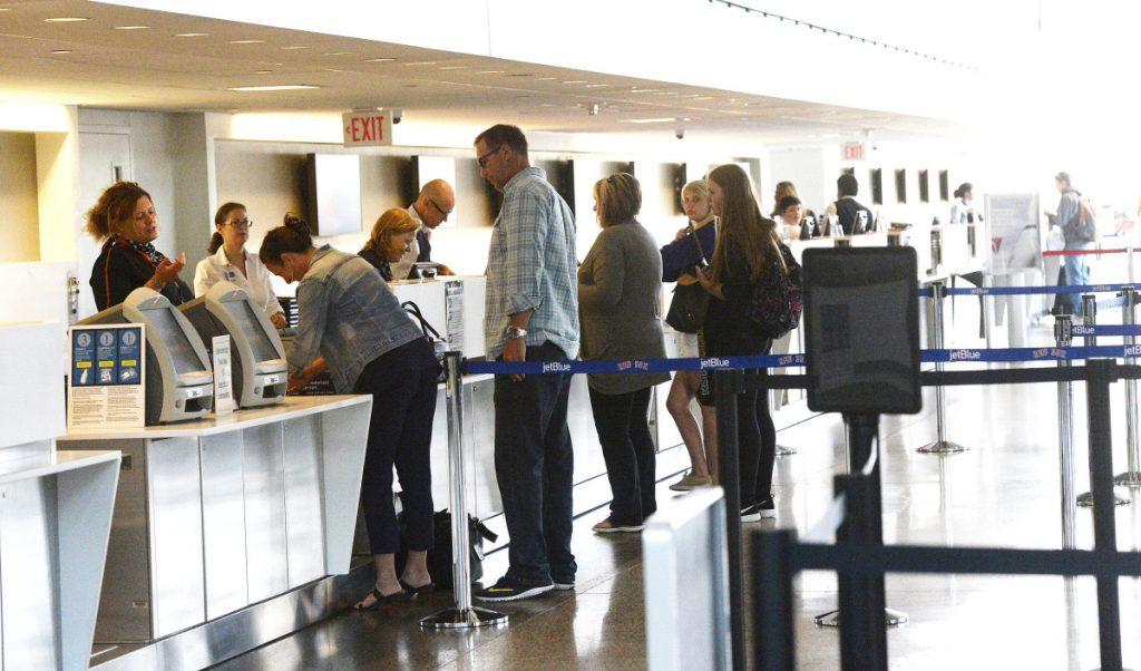 Passengers get tickets and check their luggage at the Portland International Jetport. More passengers used the airport in 2018 than in any year before.