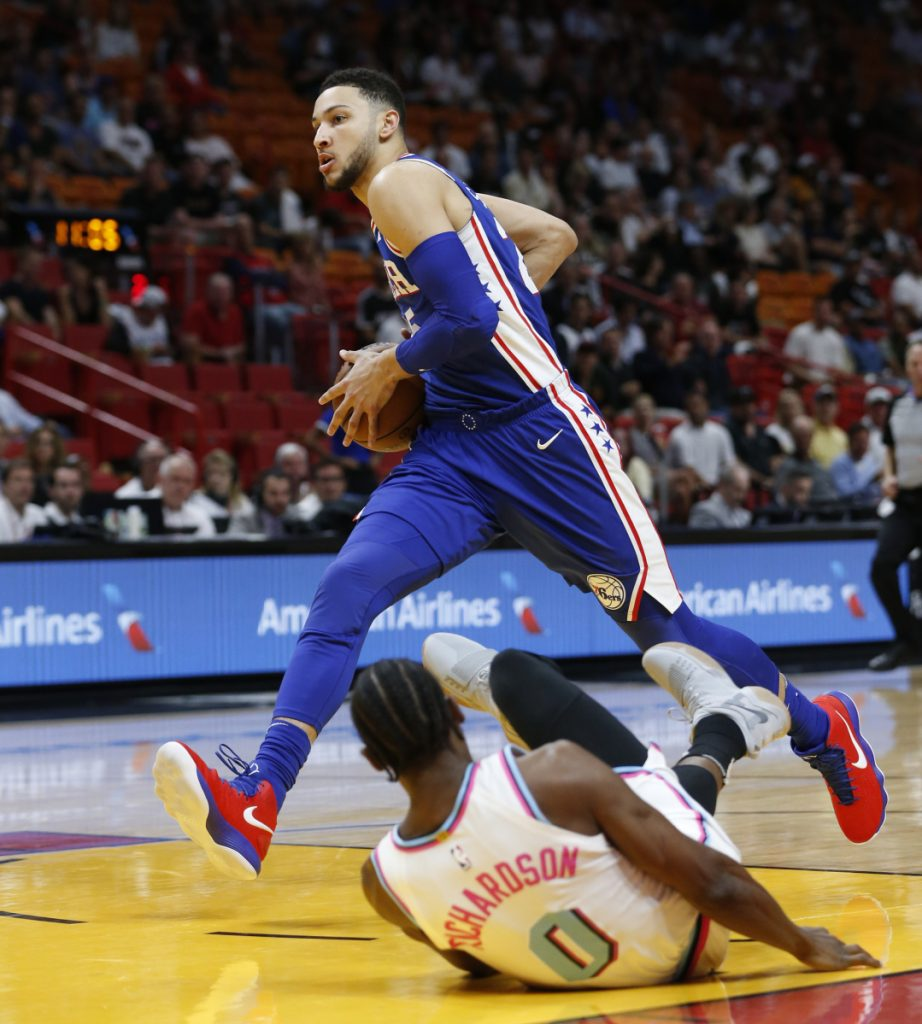 Philadelphia's Ben Simmons goes up for a shot against Miami guard Josh Richardson during the first half of their game Tuesday in Miami. The Heat won the game, 102-101.