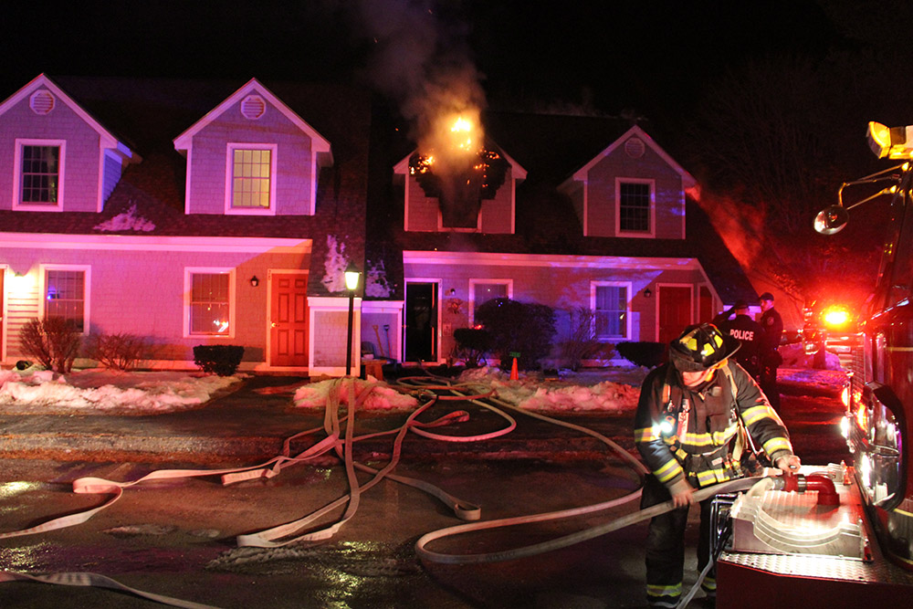 Firefighters work at the scene of a fire at 175 Rankin St. in Rockland Monday evening.