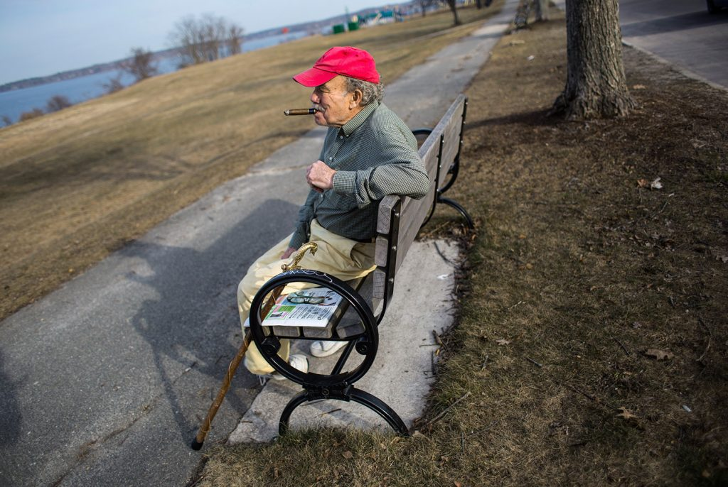 Paul Carter of Portland takes advantage of Wednesday's spring-like weather to sit and smoke a cigar on the Eastern Promenade. Portland set another temperature record.