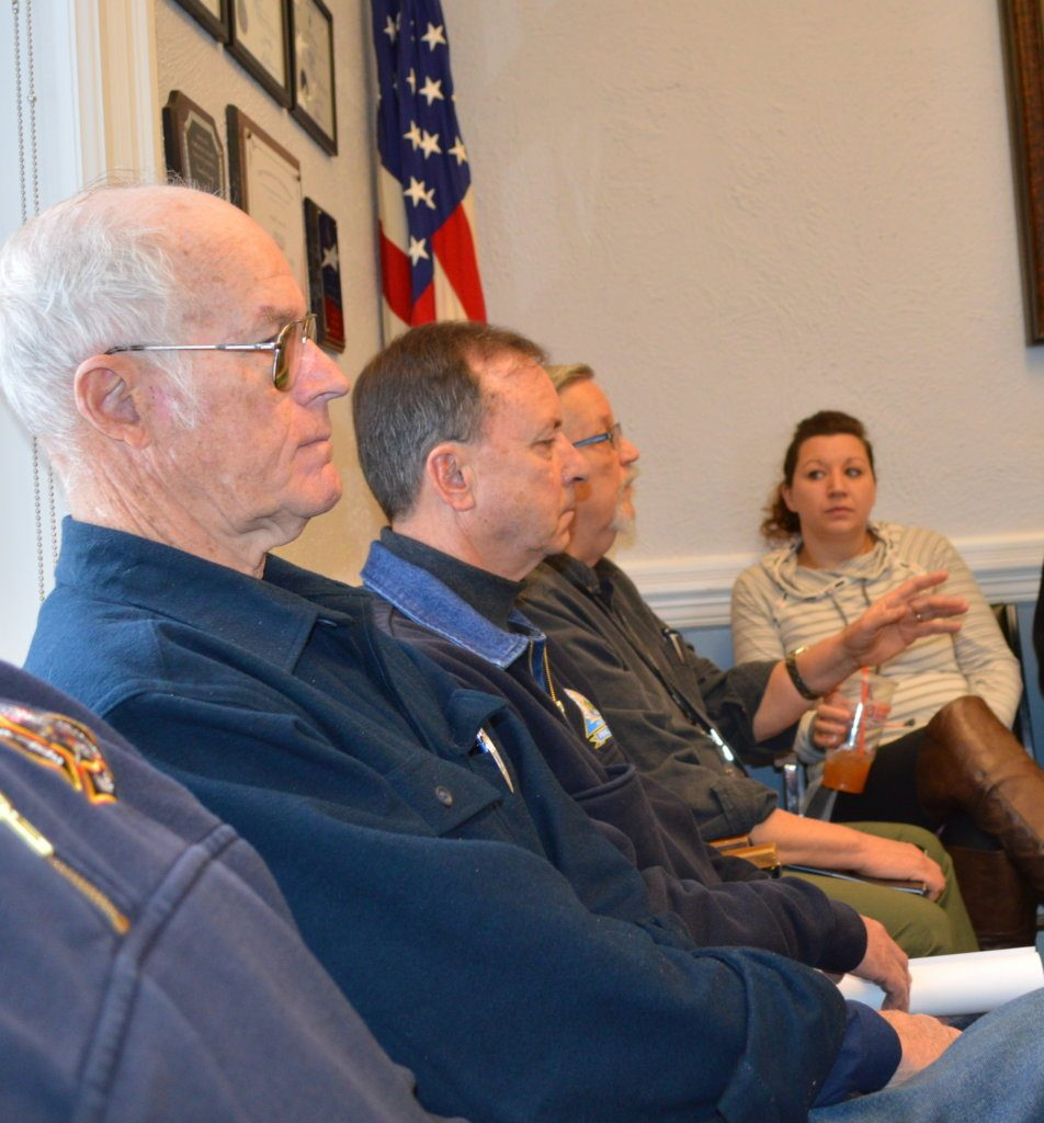Franklin County Regional Communications Center Director Stan Wheeler, third from left, addresses county commissioners Thursday in Farmington. Listening are, from left, Farmington Deputy Fire Chief Clyde Ross, county Emergency Management Agency Director/Farmington Deputy Fire Chief Tim Hardy, Wheeler, and EMA Deputy Director Amanda Simoneau. Partially pictured on the left is Farmington Fire Rescue Chief Terry Bell.