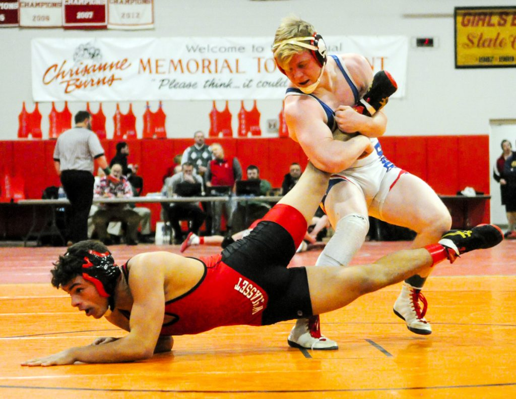 Wiscasset's Sam Strozier, left, Messalonskee's Austin Pelletier compete in the consolation semifinals at the Kennebec Valley Athletic Conference championships Saturday at Cony High School in Augusta. Pelletier won.