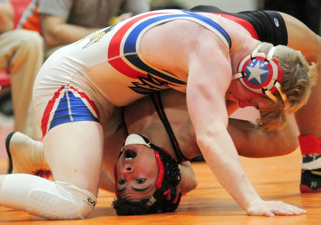 Wiscasset's Sam Strozier, bottom, and Messalonskee's Austin Pelletier compete in the consolation semifinals during the Kennebec Valley Athletic Conference championships Saturday at Cony High School in Augusta. Pelletier won.