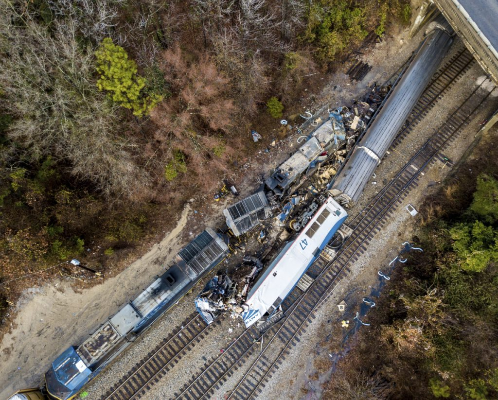 An aerial view of the site of an early morning train crash Sunday between an Amtrak train, bottom right, and a CSX freight train, top left, in Cayce, SC.