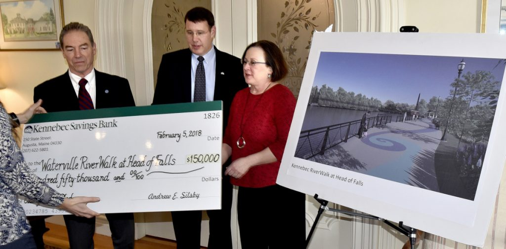 The City of Waterville received a $150,000 donation from Kennebec Savings Bank that will help fund the $1.5 million RiverWalk at Head of Falls project. The donation will go toward the project's amphitheater. Waterville City Manager Mike Roy, left, KSB President and CEO Andrew Silsby and Lisa Hallee, co-chair of the Riverwalk Advisory Committee, receive a mock check at the bank in Augusta on Monday.