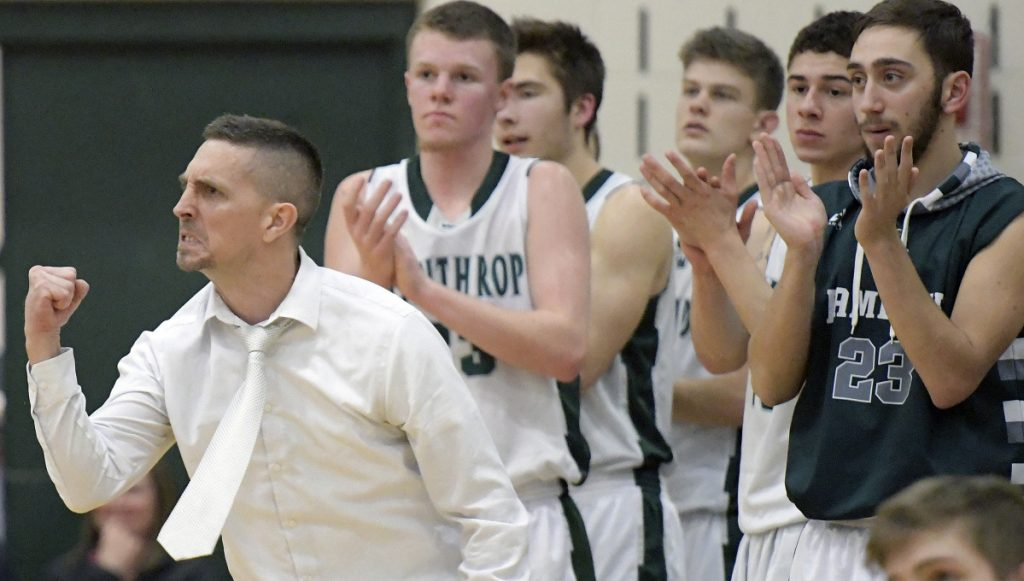 Winthrop coach Todd MacArthur and his team react to a basket during a during a Mountain Valley Conference game against Spruce Mountain on Monday night in Winthrop.