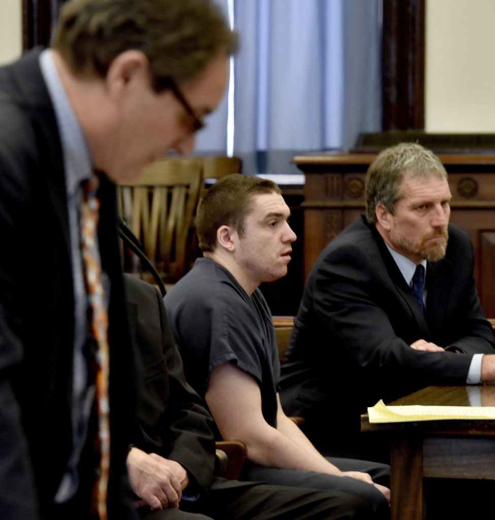 Assistant Attorney General Bud Ellis, left, reads evidence that would have been presented against defendant Jeremy Erving, center, during a hearing Wednesday in which Erving changed his plea to guilty in the death of his uncle Randy Erving in Somerset Superior Court in Skowhegan. Defense attorney Philip Mohlar is at right. Justice Robert Mullen sentenced Jeremy Erving to 27 years in prison.