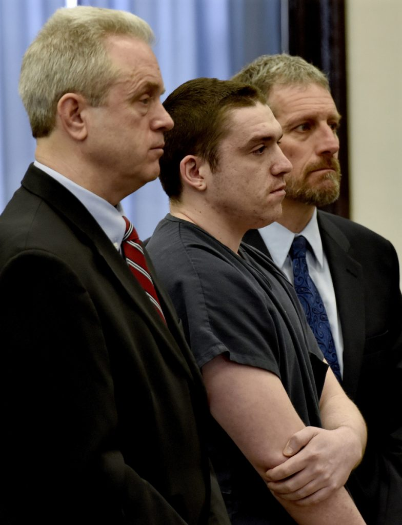 Staff photo by David Leaming Defendant Jeremy Erving, flanked by his attorneys, Peter Barnard, left, and Philip Mohlar, listens as Justice Robert Mullen sentences him to 27 years in prison for the murder of his uncle Randy Erving in 2016.