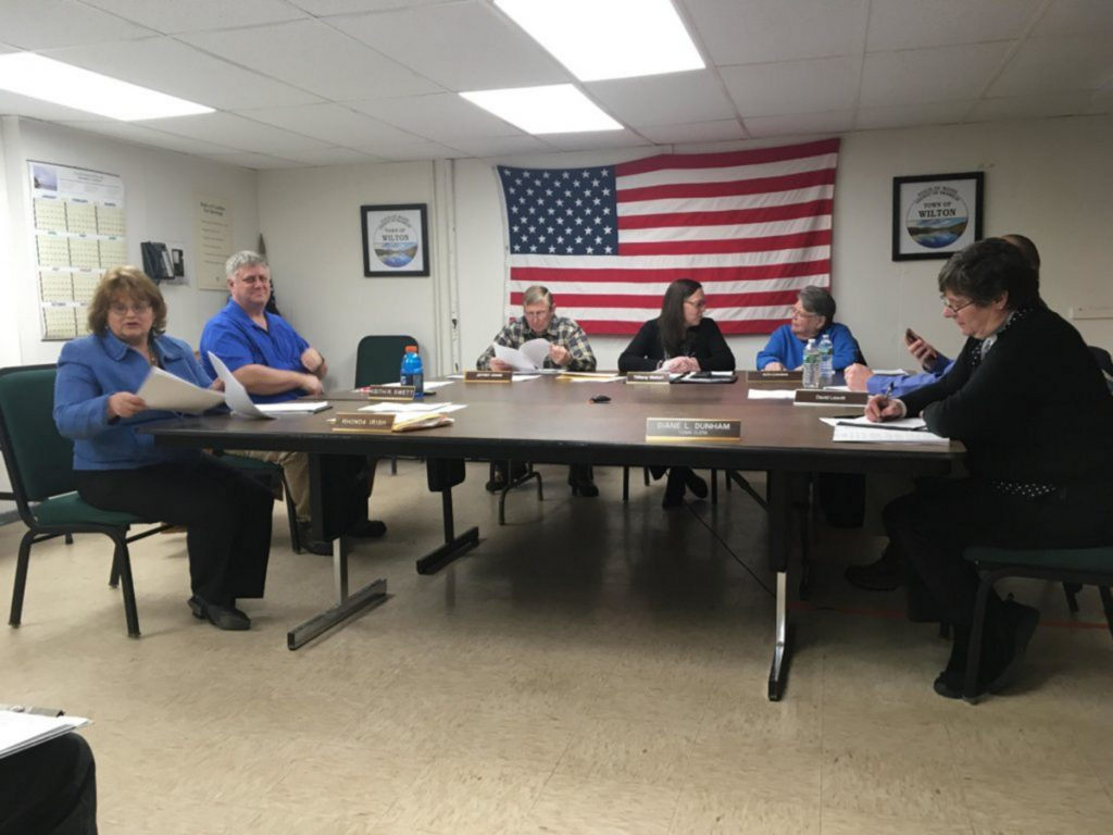 Town Manager Rhonda Irish, left, meets with Selectpersons Keith Swett, Jeffrey Adams, Tiffany Maiuri, Ruth Cushman, David Leavitt and Town Clerk Diane Dunham on Tuesday night at the Wilton Town Office. The board discussed marijuana regulations with a member of the Planning Board.